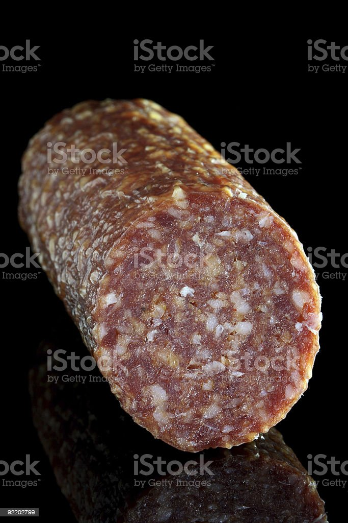 food - Italian Pepperoni salami with a piece cut off royalty-free stock photo