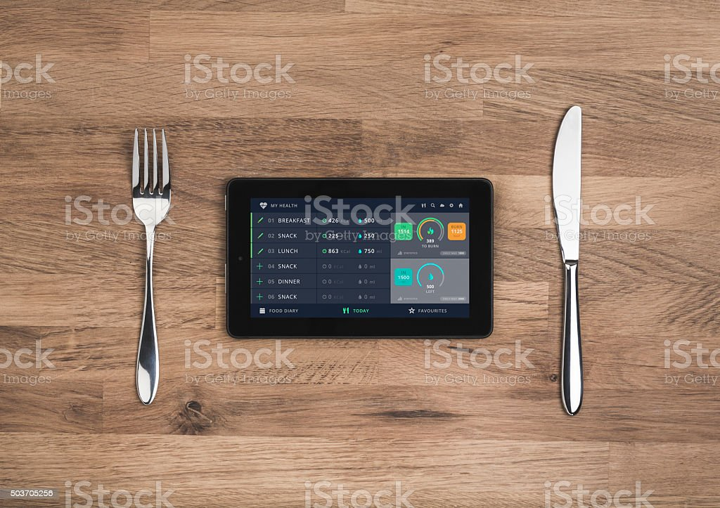 Food meal planning app on mobile tablet stock photo