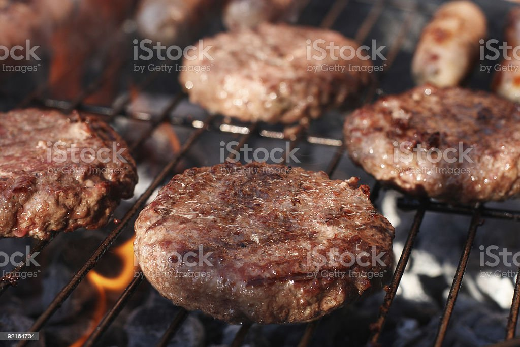 food meat - burgers on barbecue grill. royalty-free stock photo