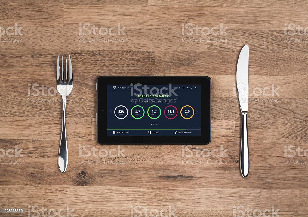 Food nutrition information on mobile tablet stock photo