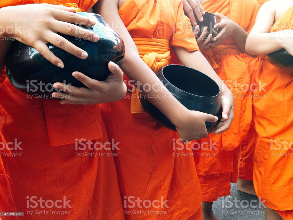 food offering to a monk stock photo