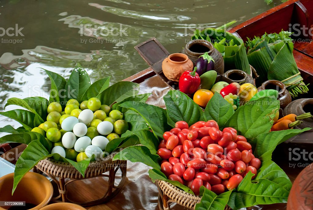 Food on a boat at floating market stock photo