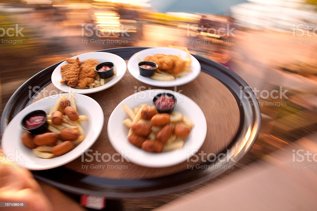 Food on a tray being delivered to tables stock photo