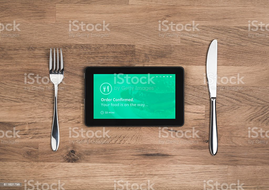 food order online confirmation on tablet stock photo
