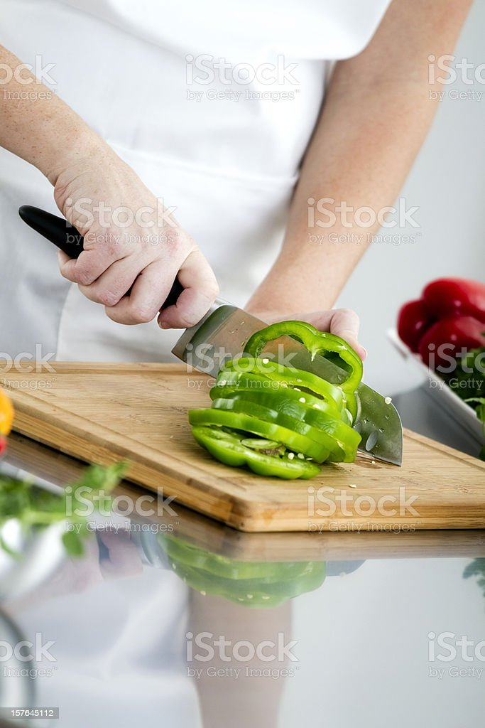 Food Preparation - Cutting a Green Bell Pepper royalty-free stock photo