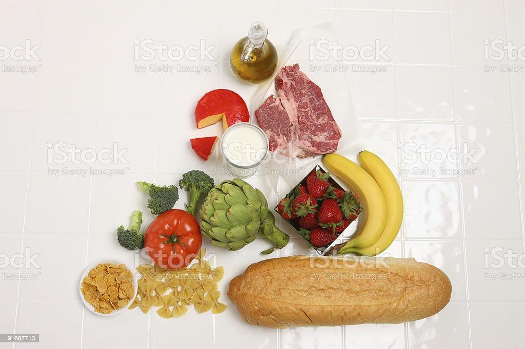 Food pyramid on white tile stock photo