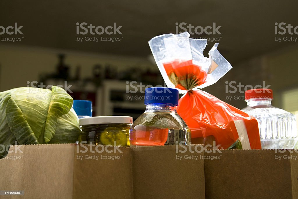Food:  Sacks of groceries on the home kitchen counter royalty-free stock photo
