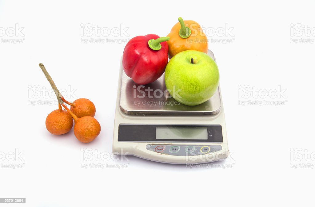 food scale with fruits apple banana and orange stock photo