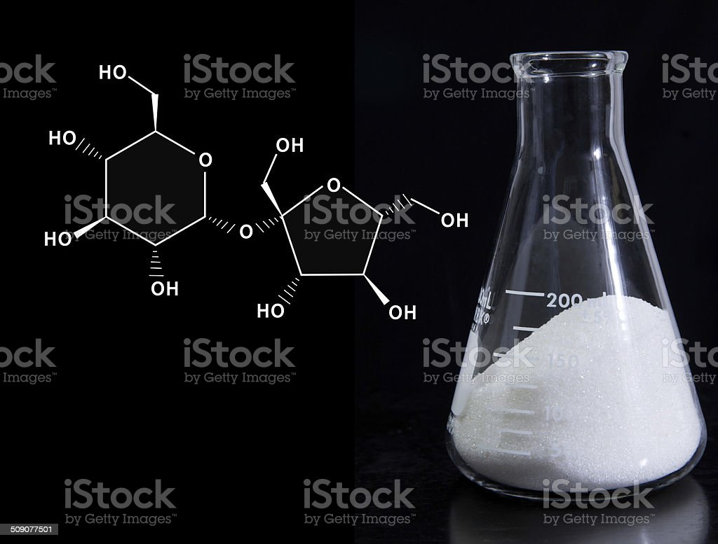 Food science - table sugar with molecular formula of sucrose stock photo