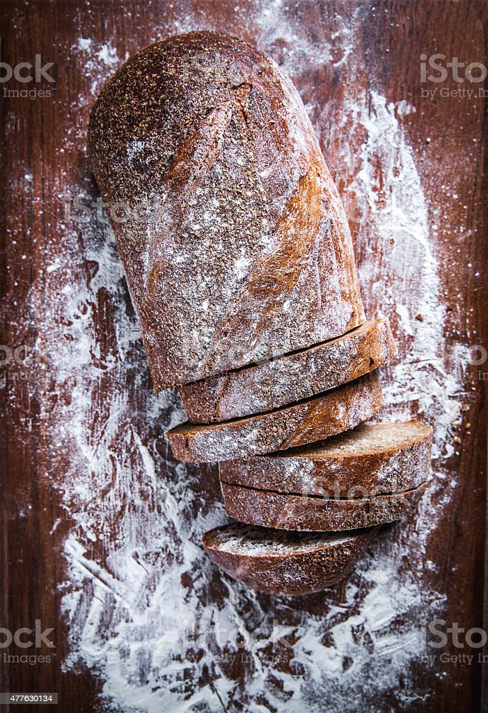 food. sliced rye bread on a wooden background stock photo