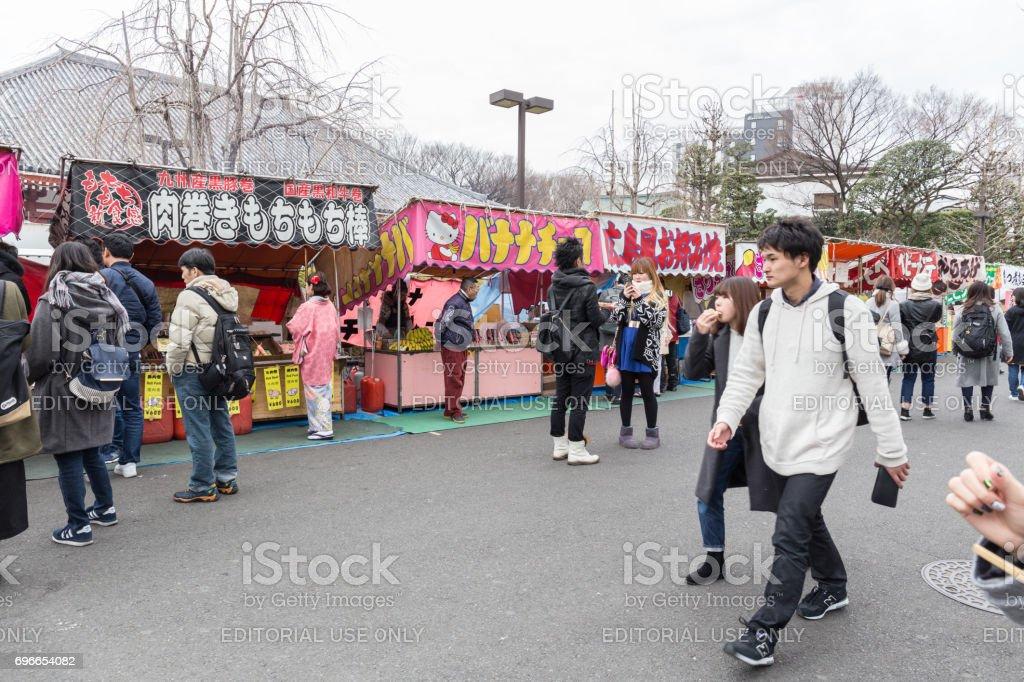 food stalls near Hozomon, Treasure house gate of Sensoji temple in winter February 18, 2017 in Tokyo, Japan stock photo
