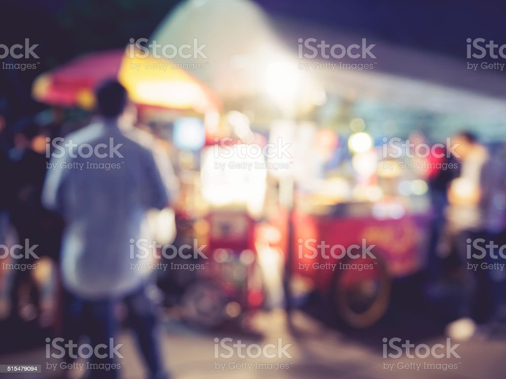 Food store market Event outdoor Blurred people background stock photo