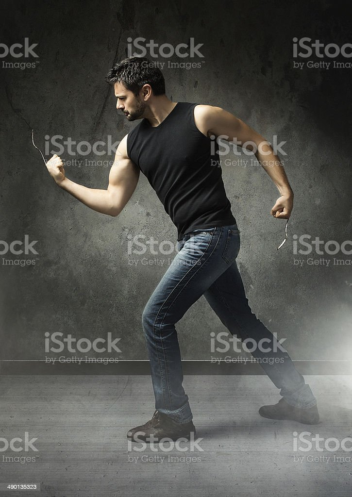 food super hero in aggressive mode with forks stock photo