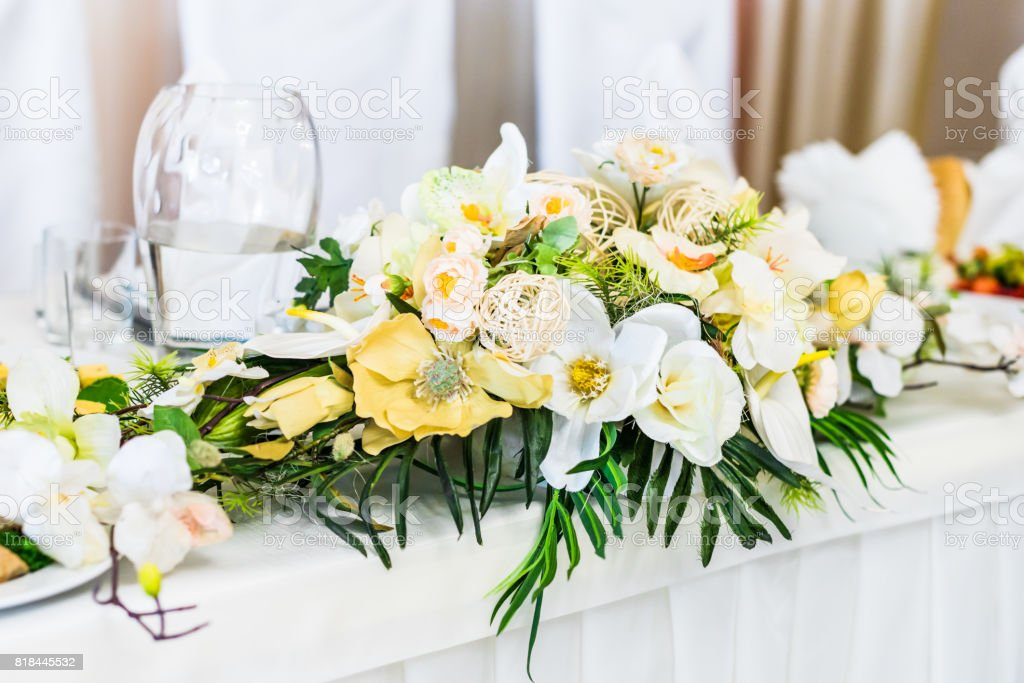 Food table decorated with flowers stock photo