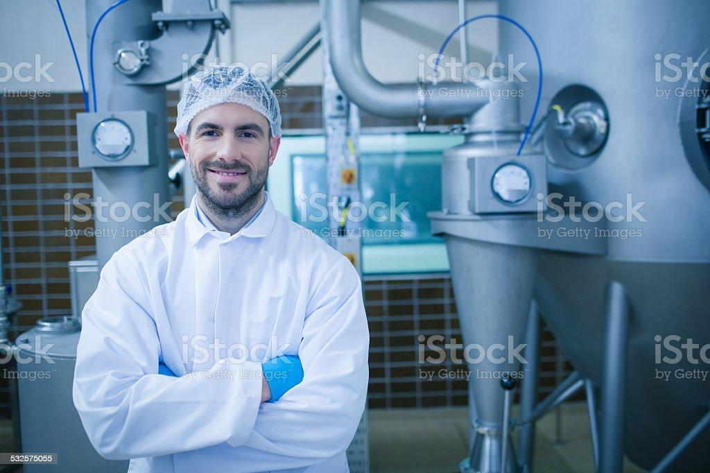 Food technician smiling at camera stock photo
