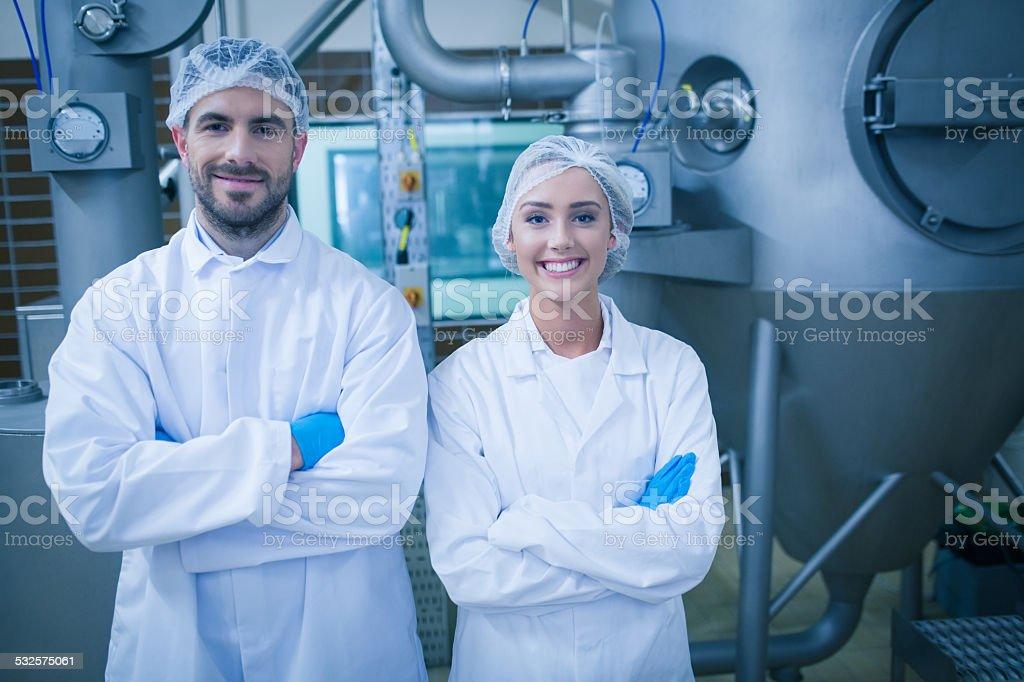 Food technicians smiling at camera stock photo