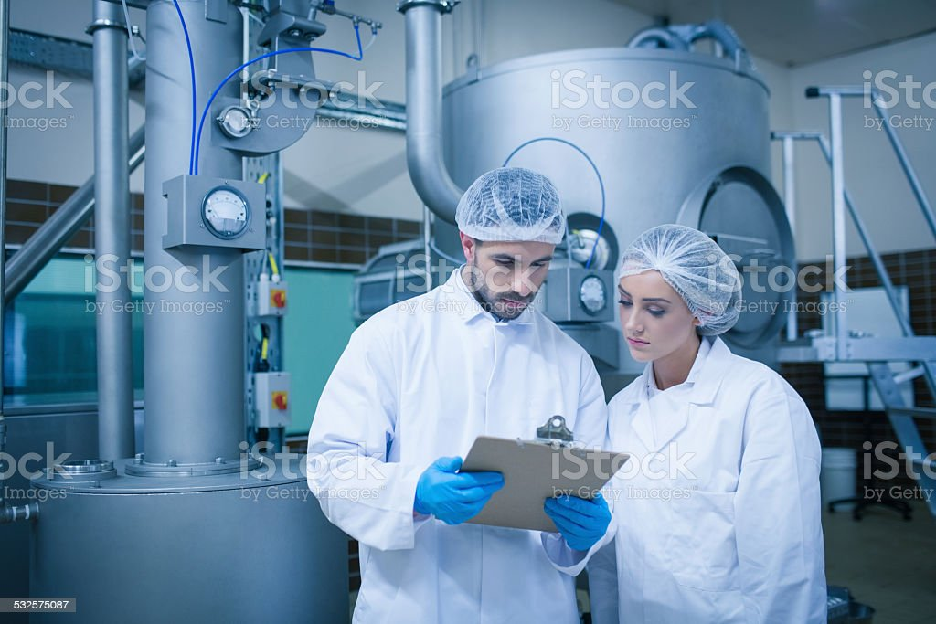 Food technicians working together stock photo