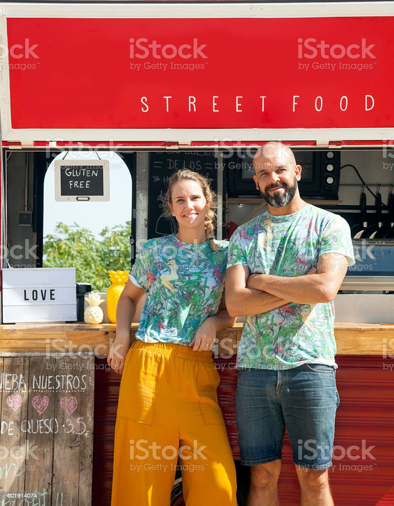 Food truck and owners stock photo