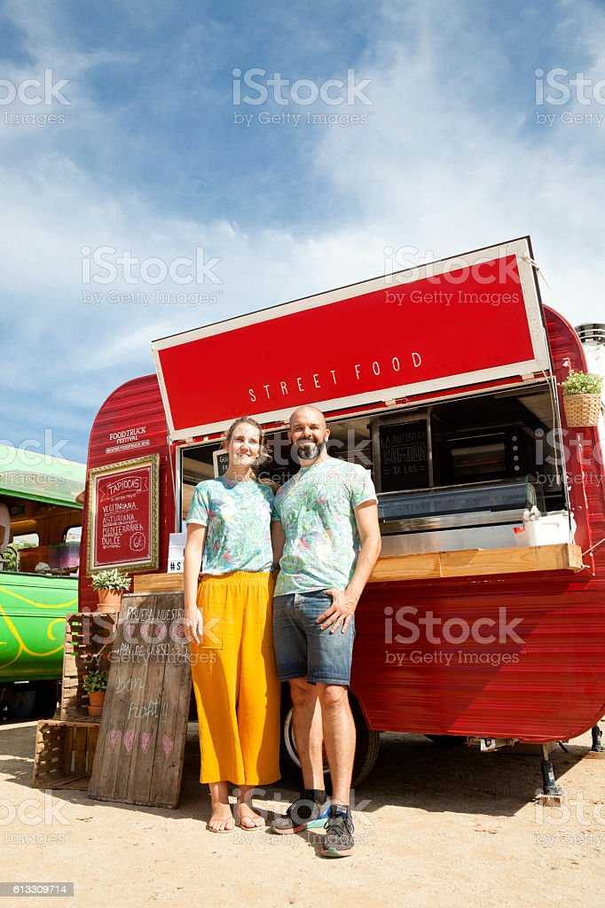 Food truck and proud owners stock photo