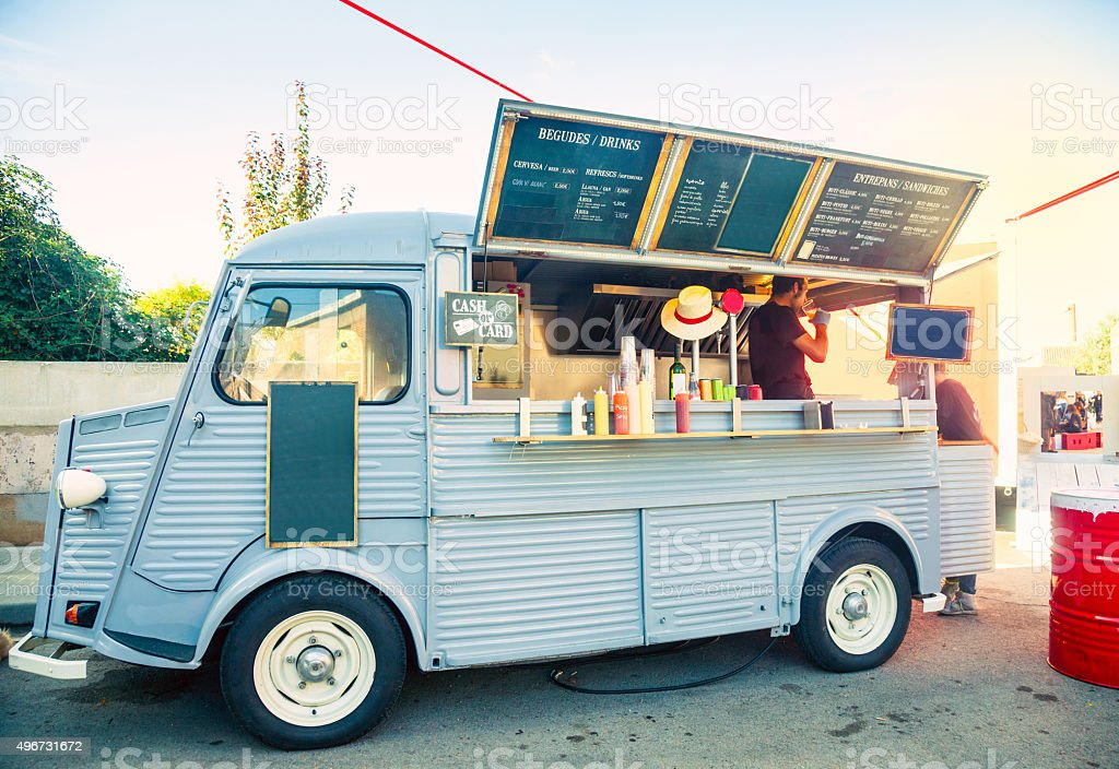 Food truck open and porked in the street