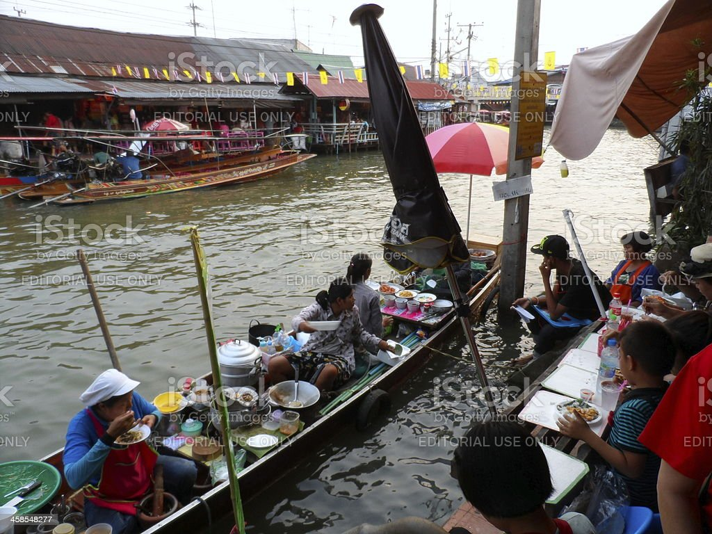 Food Vendors At Amphawa Floating Market In Thailand royalty-free stock photo