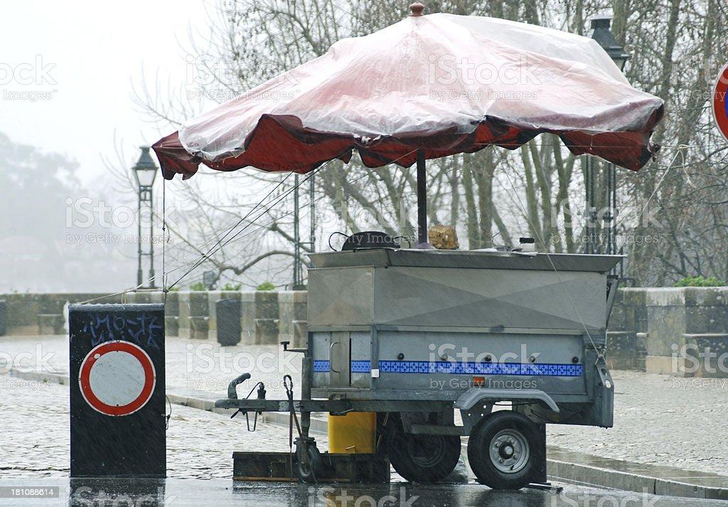 Food vendor's trailer temporarily abandoned during hard rain stock photo