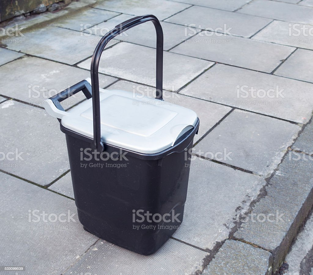 Food waste container on pavement for collection stock photo