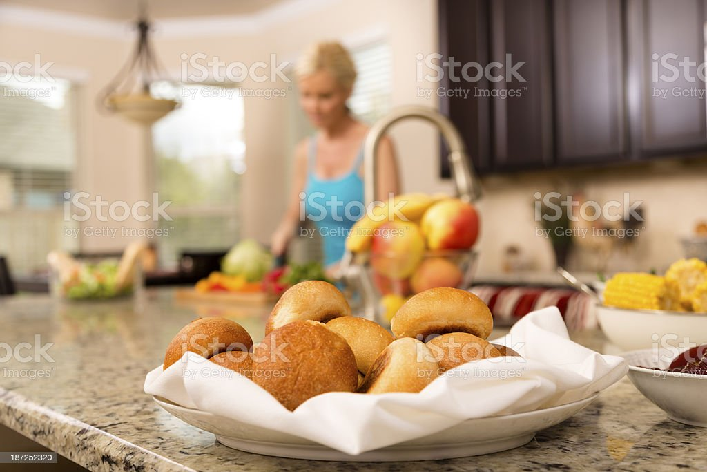 Food:  Woman prepares meal in home kitchen. royalty-free stock photo