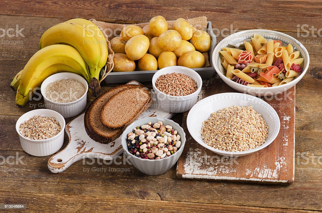 Foods high in carbohydrate on wooden background. stock photo