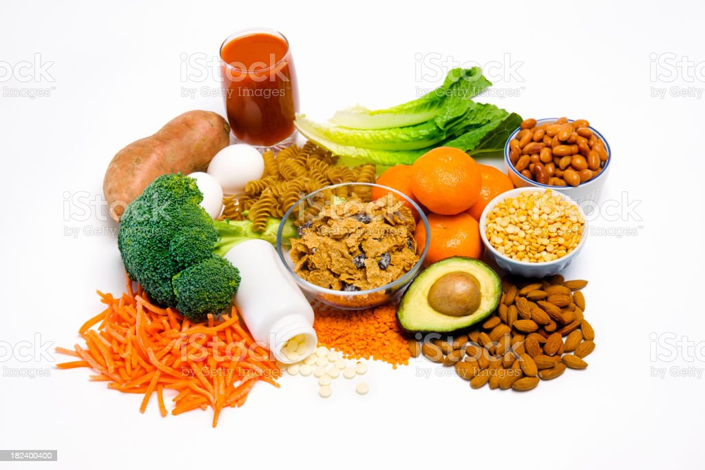Foods rich in Folic Acid with supplements. stock photo