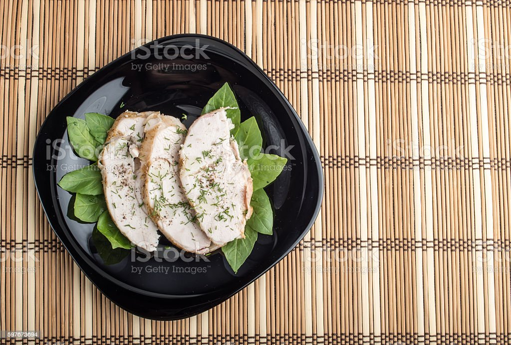Foodstyle background with three slices of roasted chicken stock photo