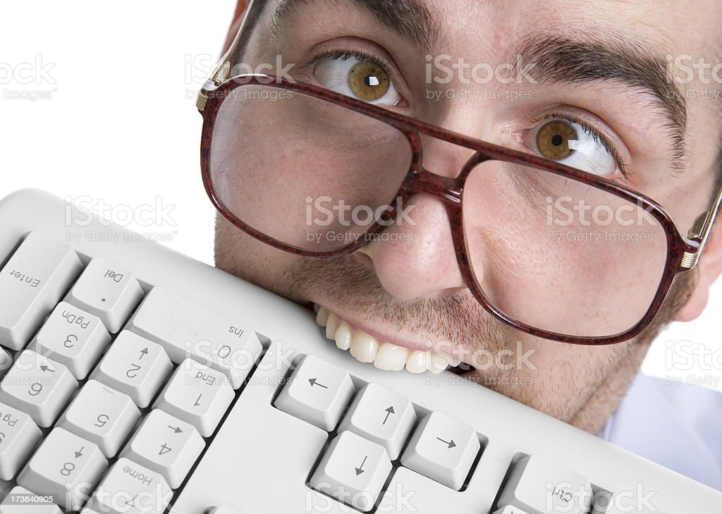 Fool businessman eating keyboard stock photo