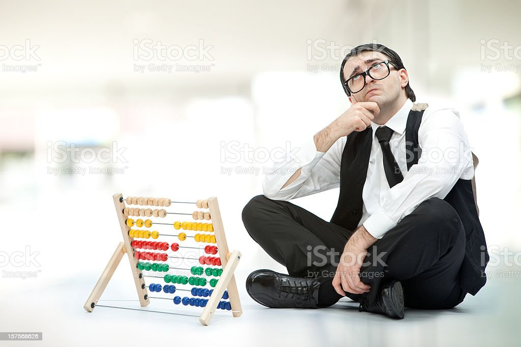 fool man with an abacus in grey environment royalty-free stock photo