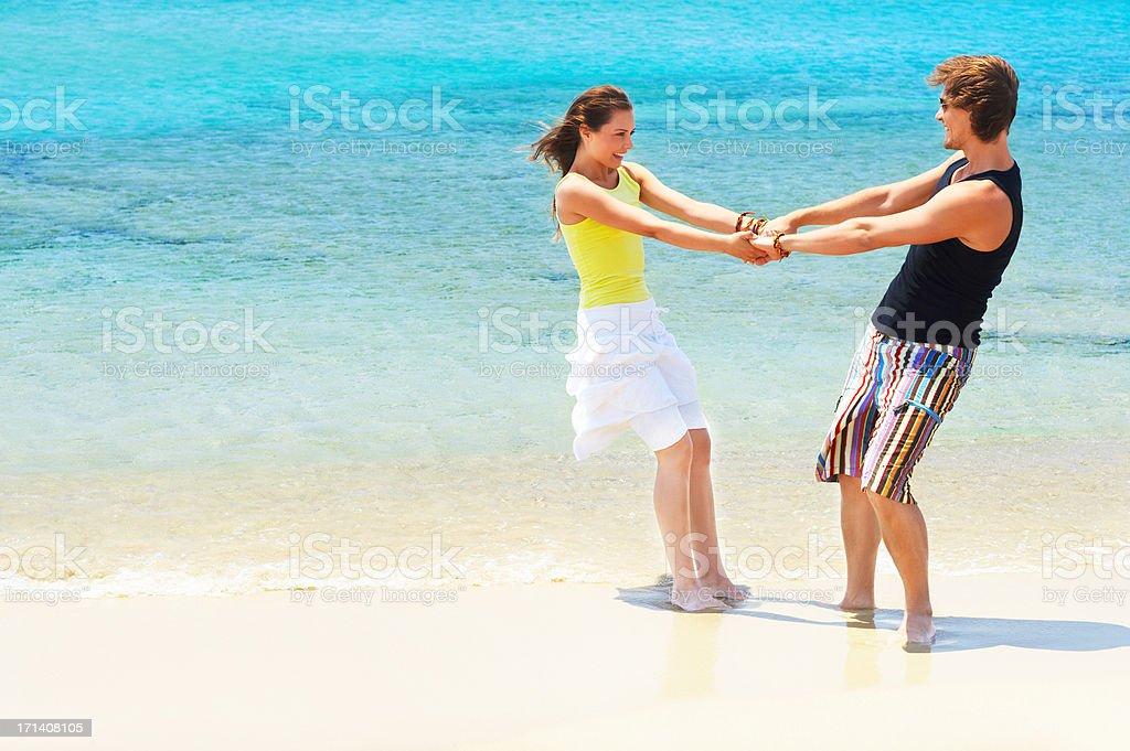 Fooling around on the beach stock photo
