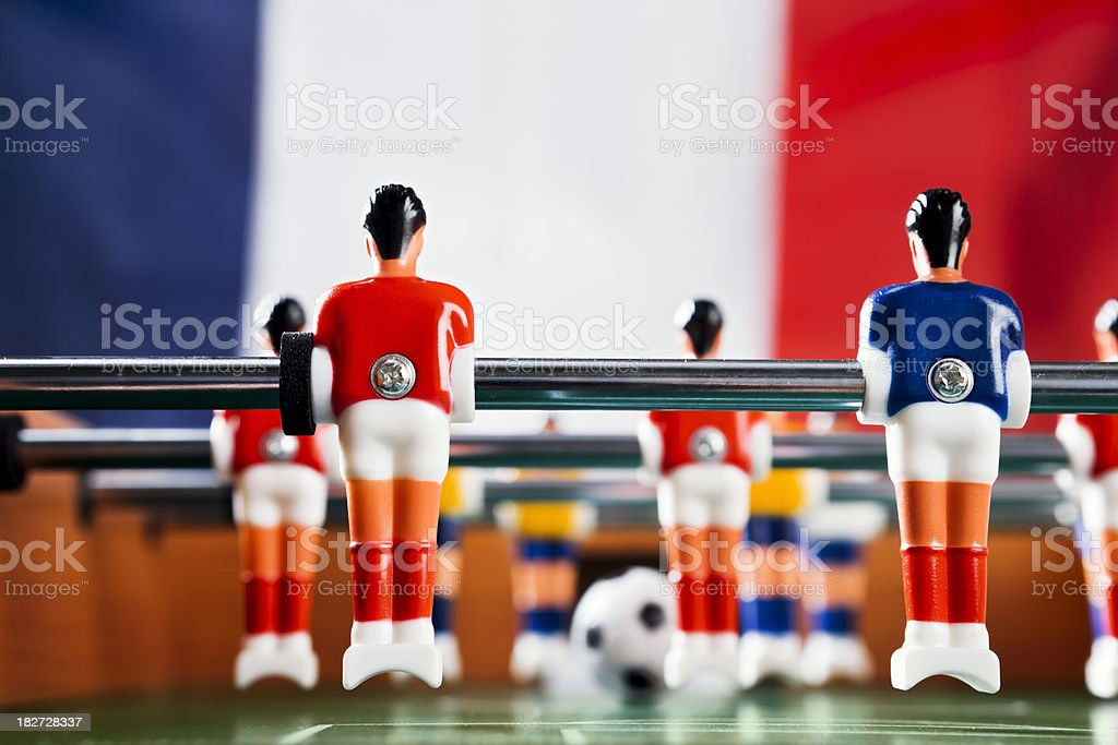 Foosball game in front of French national flag stock photo