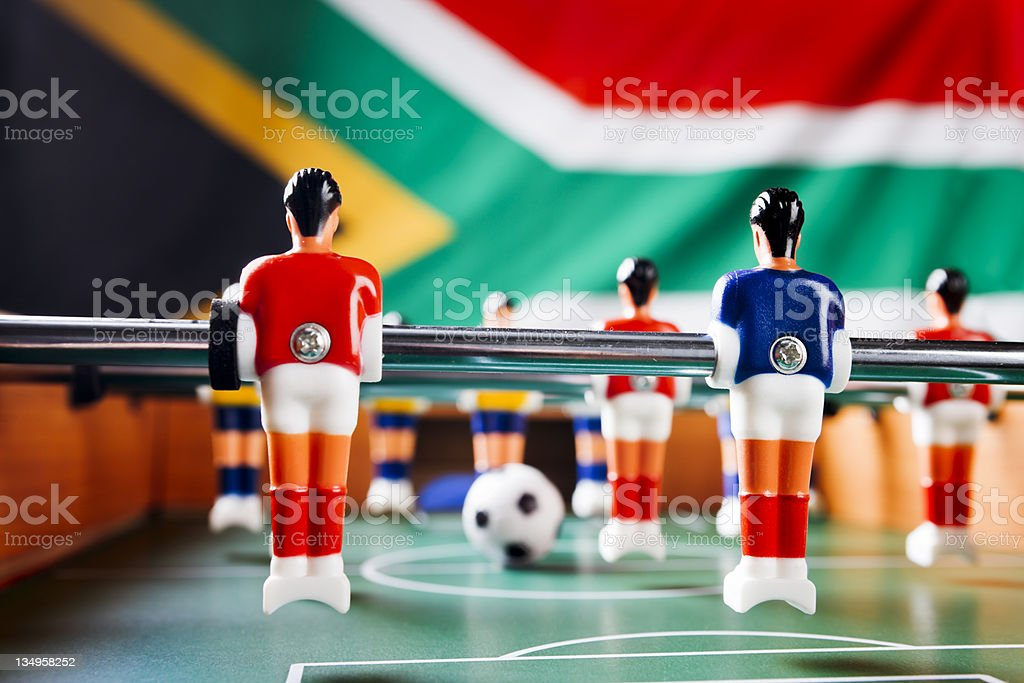 Foosball in front of South African national flag royalty-free stock photo