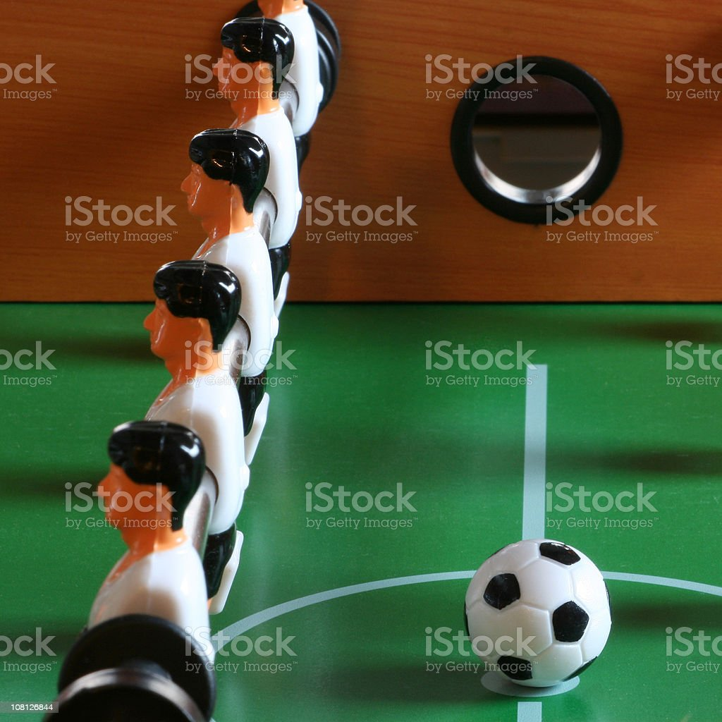 Foosball players facing away from the ball symbolizing disobedience stock photo