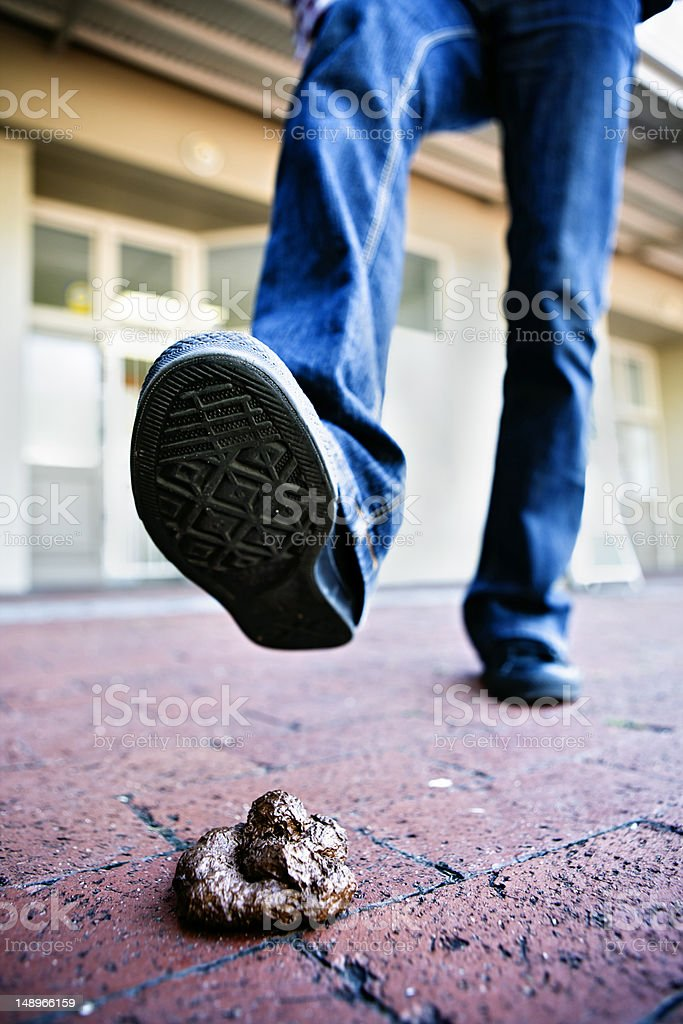 Foot about to step in dog faeces left  on sidewalk royalty-free stock photo