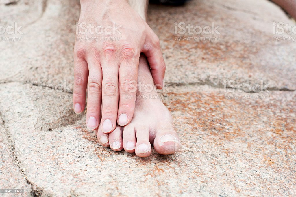 foot and hand of man royalty-free stock photo