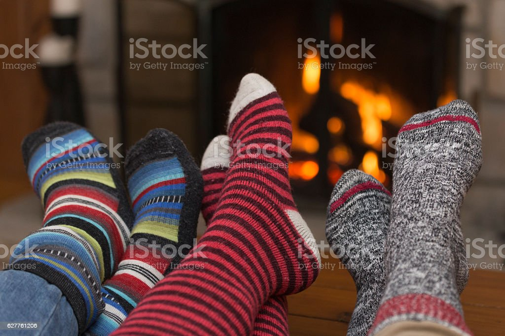 Foot and Suck Behind Fireplace stock photo