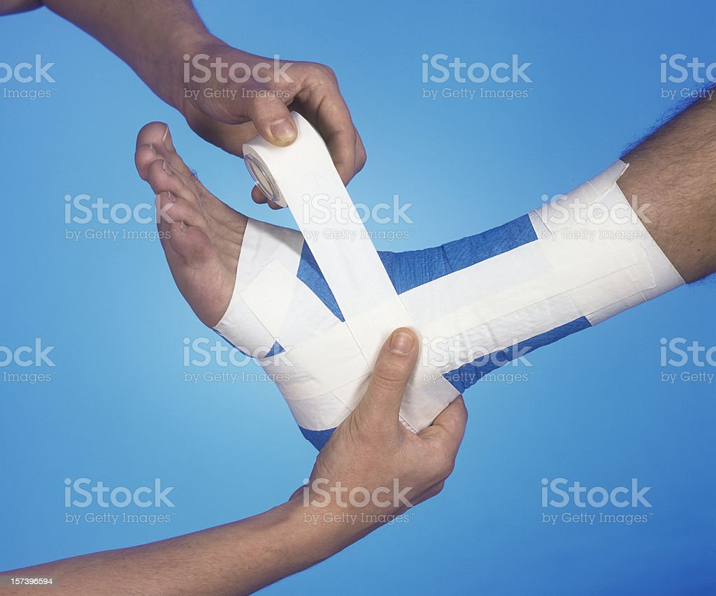 Foot breach: fixing of bandage royalty-free stock photo