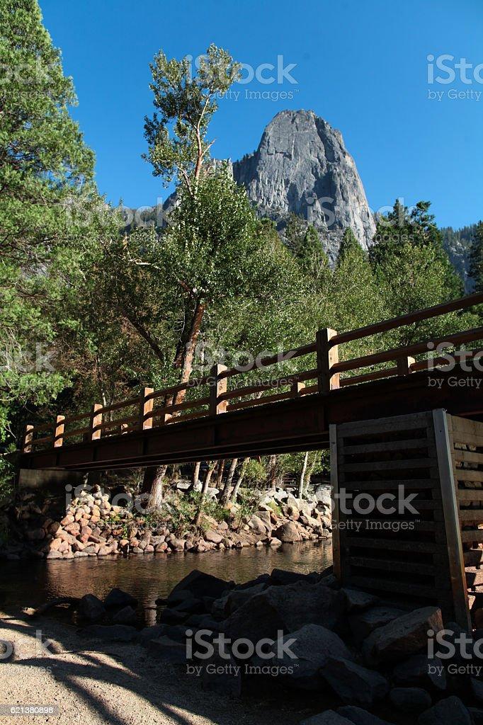 Foot bridge across the Merced River stock photo