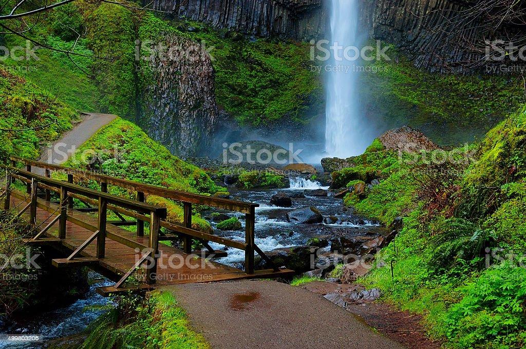 Foot bridge at base of Lautrolla Falls stock photo
