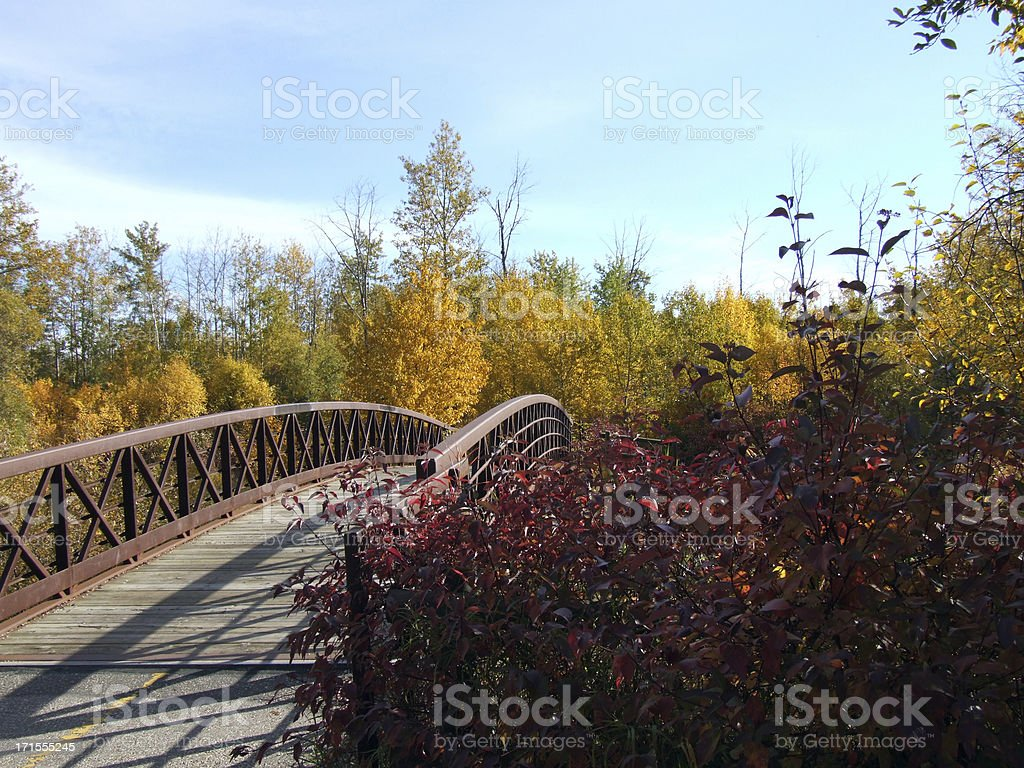 Foot bridge crossing Bear Creek in Autumn royalty-free stock photo