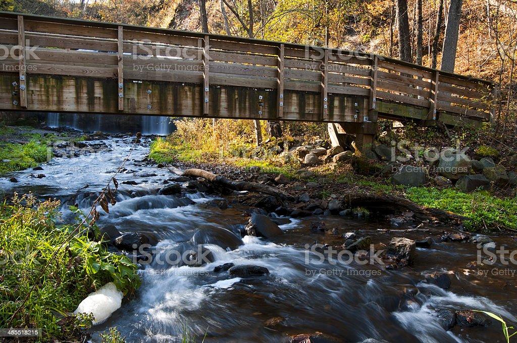 Foot Bridge over a Creek royalty-free stock photo