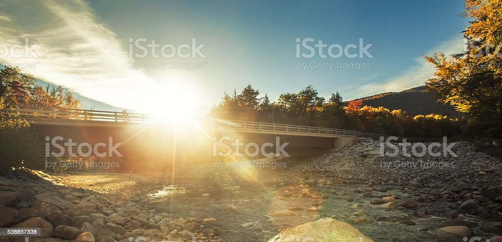 foot bridge with no people at dusk, maine stock photo
