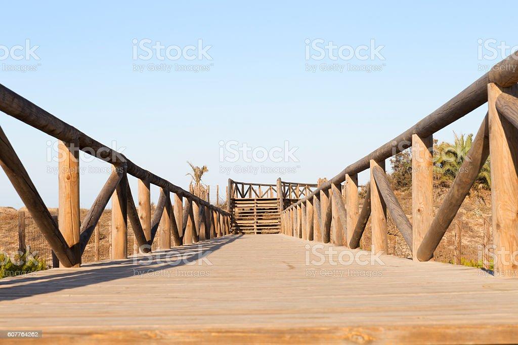 foot bridge with wooden fences stock photo