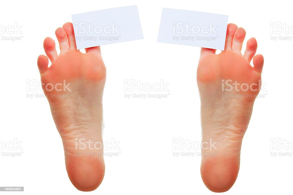 Foot Holding Business Card stock photo