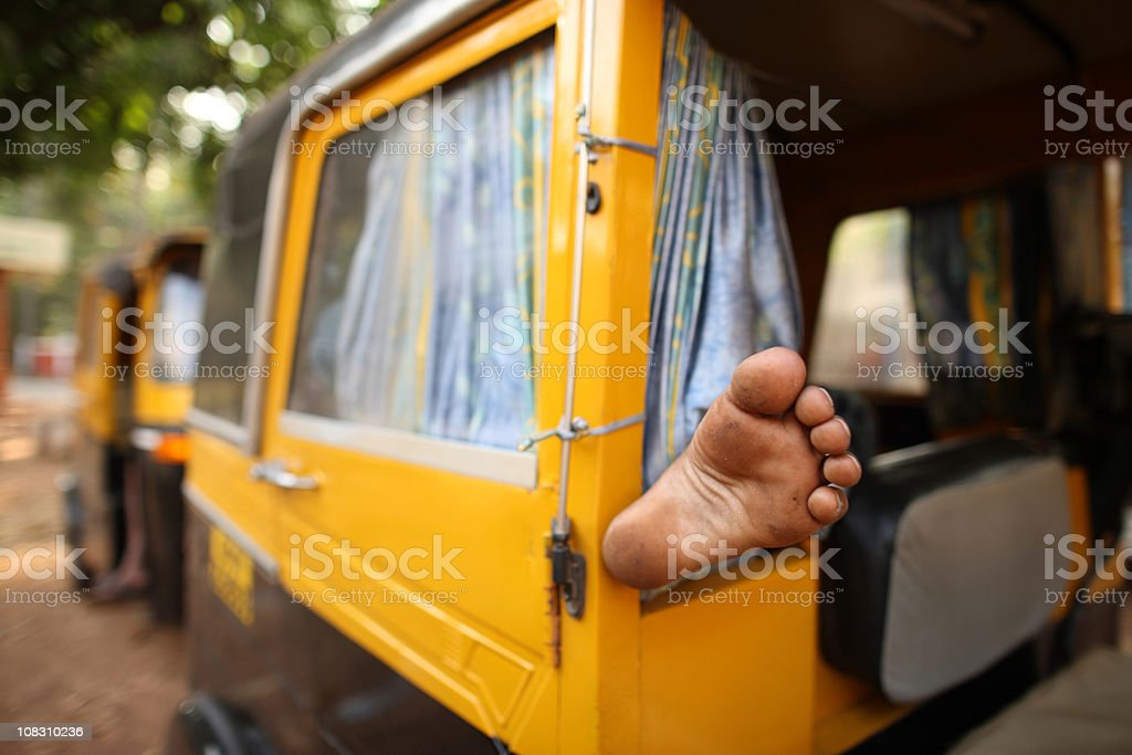 Foot in auto rickshaw stock photo