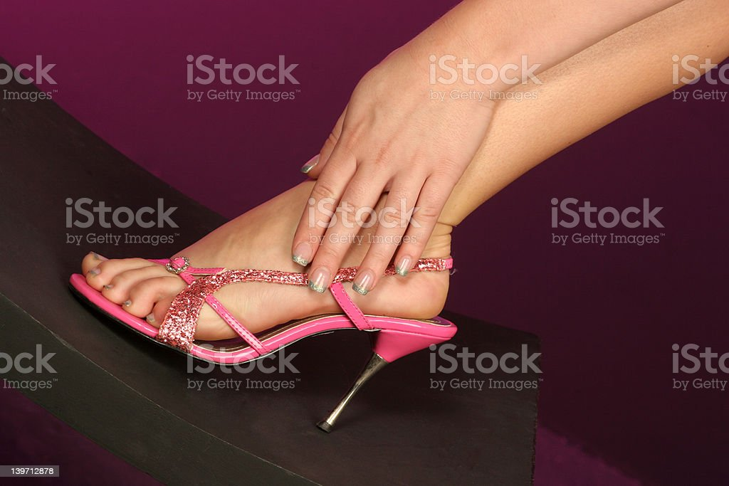 foot in hand stock photo